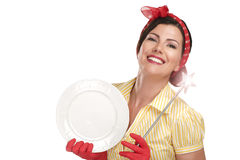 Young beautiful woman housewife showing a magic wand on dishes Stock Photography