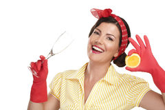 Young beautiful woman housewife showing perfect washed dishes Stock Photos