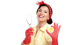Young beautiful woman housewife showing perfect washed dishes Stock Photo