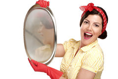 Young beautiful woman housewife showing perfect washed dishes Royalty Free Stock Photo