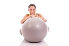 Young, beautiful woman hugging big gray ball Royalty Free Stock Photo