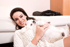Young beautiful woman hugging her puppy Royalty Free Stock Photography