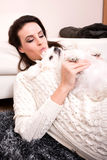 Young beautiful woman hugging her puppy Royalty Free Stock Photo