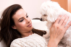 Young beautiful woman hugging her puppy Royalty Free Stock Images