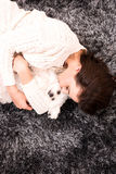 Young beautiful woman hugging her puppy Stock Photos