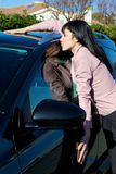 Young beautiful woman hugging and kissing her new car Stock Photography
