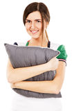 Young beautiful woman hugging a pillow Stock Photos