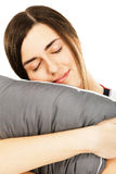 Young beautiful woman hugging a pillow Stock Images