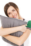 Young beautiful woman hugging a pillow Royalty Free Stock Photo