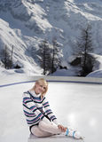 Young beautiful woman with ice skates Stock Photography