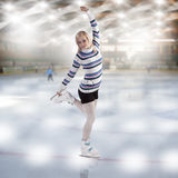 Young beautiful woman ice skating Royalty Free Stock Photos