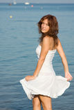 Young Beautiful Woman In A White Dress Stock Images