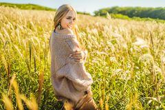 Free Young Beautiful Woman In Autumn Landscape With Dry Flowers, Wheat Spikes. Fashion Autumn, Winter. Sunny Autumn, Cozy Royalty Free Stock Photos - 153193908