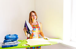 Young beautiful woman ironing clothes. Stock Photography
