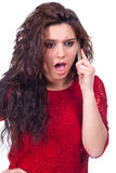 Young beautiful woman irritated on the phone Royalty Free Stock Photos