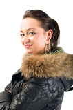 Young beautiful woman in jacket with fur Royalty Free Stock Photography