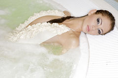 Young beautiful woman in jacuzzi Stock Photography
