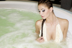 Young beautiful woman in jacuzzi Stock Images