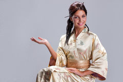 Young Beautiful Woman In Japanese National Clothing Royalty Free Stock Photo