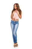 Young Beautiful Woman In Jeans And Cork High Heels Stock Photography