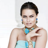 Young beautiful woman with jewelry Stock Photography