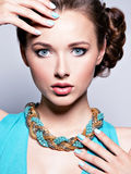 Young beautiful woman with jewelry. Royalty Free Stock Image