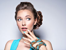 Young beautiful woman with jewelry. Royalty Free Stock Photos