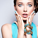 Young beautiful woman with jewelry. Stock Photo