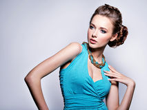 Young beautiful woman with jewelry. Stock Photos