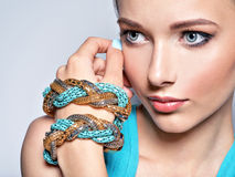 Young beautiful woman with jewelry. Stock Image