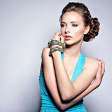 Young beautiful woman with jewelry. Stock Images