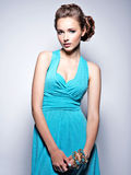 Young beautiful woman with jewelry. Royalty Free Stock Photography
