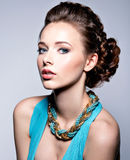 Young beautiful woman with jewelry. Royalty Free Stock Images