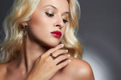Young beautiful woman with jewelry.Sexy Blond girl