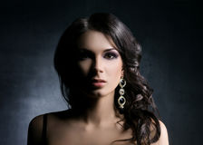 Young and beautiful  woman in jewels over dark background Stock Photos