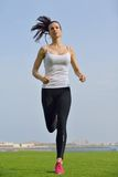 Young beautiful  woman jogging  on morning Royalty Free Stock Photo