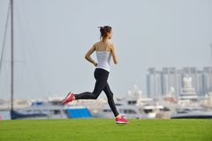 Young beautiful  woman jogging  on morning Royalty Free Stock Images
