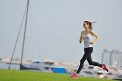 Young beautiful  woman jogging  on morning Stock Photo