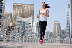 Young beautiful  woman jogging  on morning Royalty Free Stock Image