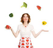 Young beautiful woman juggling with vegetables Royalty Free Stock Photo