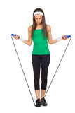 Young beautiful woman with jump rope Royalty Free Stock Images