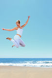 Young beautiful woman jumping Royalty Free Stock Photo