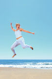 Young beautiful woman jumping Royalty Free Stock Images