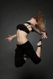 Young beautiful woman jumping stock photo