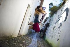 Young beautiful woman jumping Stock Photography