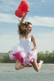 Young beautiful woman jumping with balloons. Stock Images