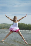 Young beautiful woman jumping on the beach. stock photos