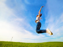 Young beautiful woman jumping for joy Royalty Free Stock Photo
