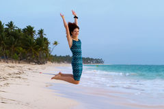Young beautiful woman jumping on a tropical beach Stock Photography