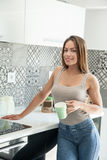 Young beautiful woman on kitchen Royalty Free Stock Photo
